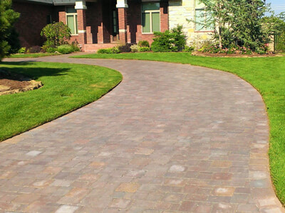 We work with the flow of vehicular traffic and use a concrete or gravel base to install stone driveways, paver driveways, and brick driveways.