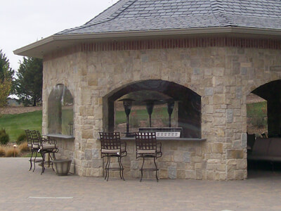 Our skilled team of artisans creates tailored outdoor stone kitchens, stone grills, and more to accommodate your outdoor cooking needs.