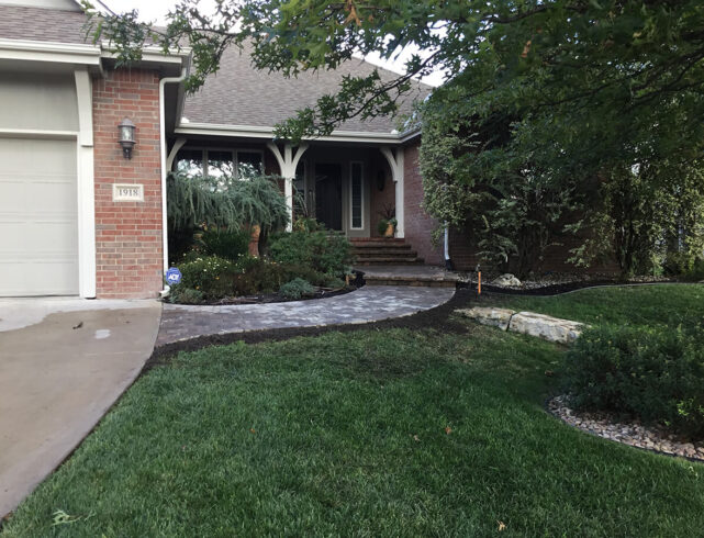 Removal and installation of stone walkway in Wichita, KS