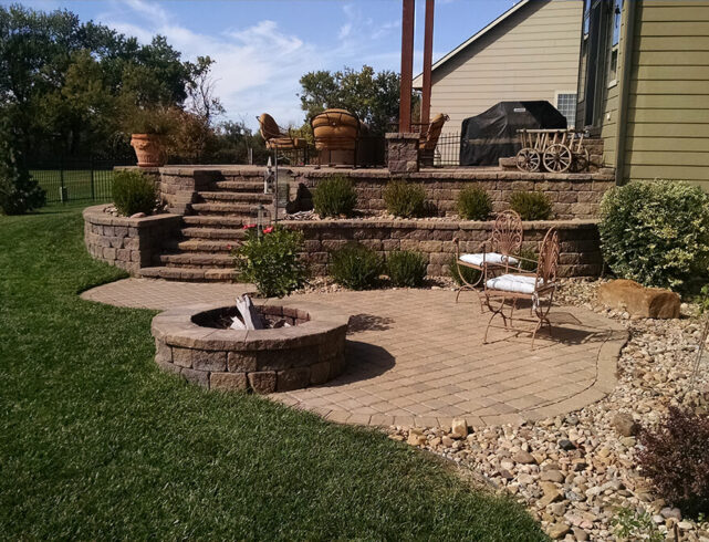 Upper paver patio/lower paver patio installation/stone fire pit installation in Wichita, KS
