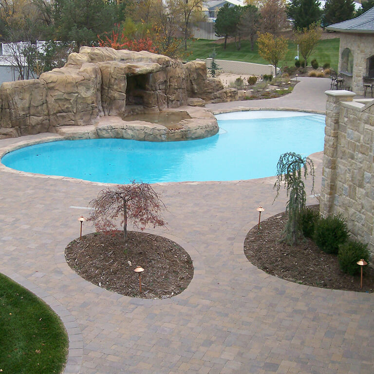 Heartstone's residential hardscaping projects include concrete interlocking pavers, stone patios, concrete pavers, brick patios, pool paver patios, concrete walkways, step structures, brick driveways, natural stonework, custom stone firepits, concrete recycling, and more.