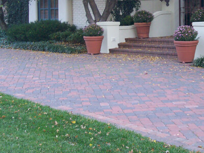 Our team installs a concrete or gravel base and uses various paver styles and colors in stone or brick tailored to design and enhance your home's curb appeal